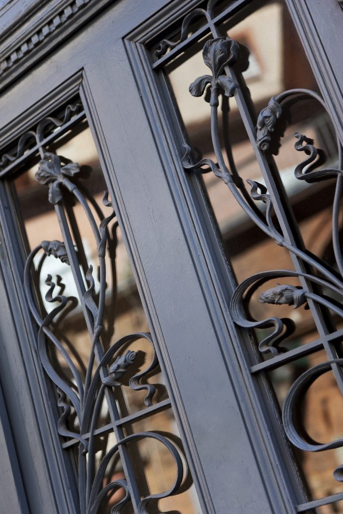 Close up of a vintage wrought iron door of a French house
