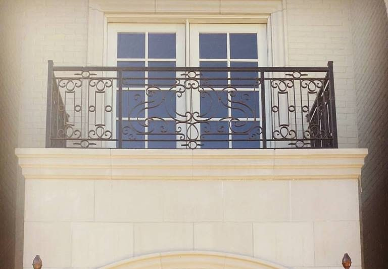 balcony with wrought iron railing