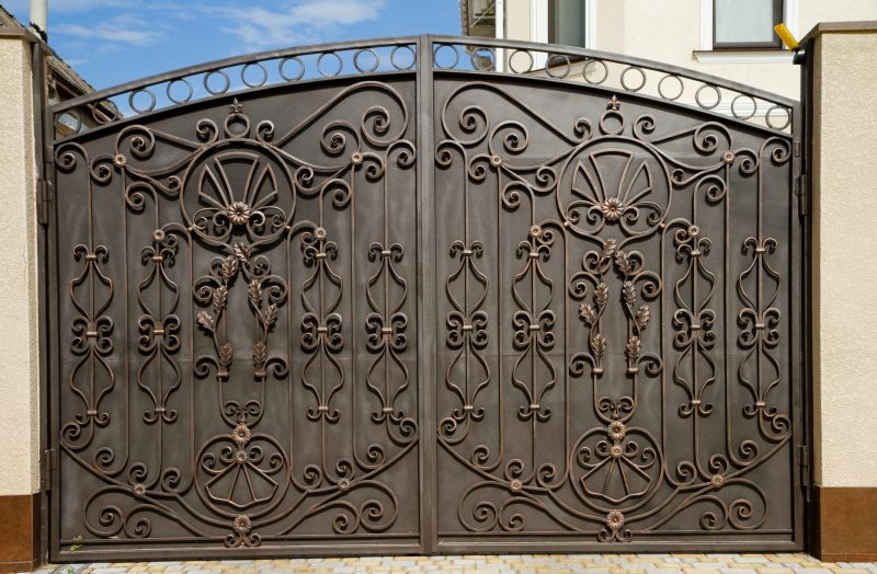 beautiful wrought iron doors in front of a home