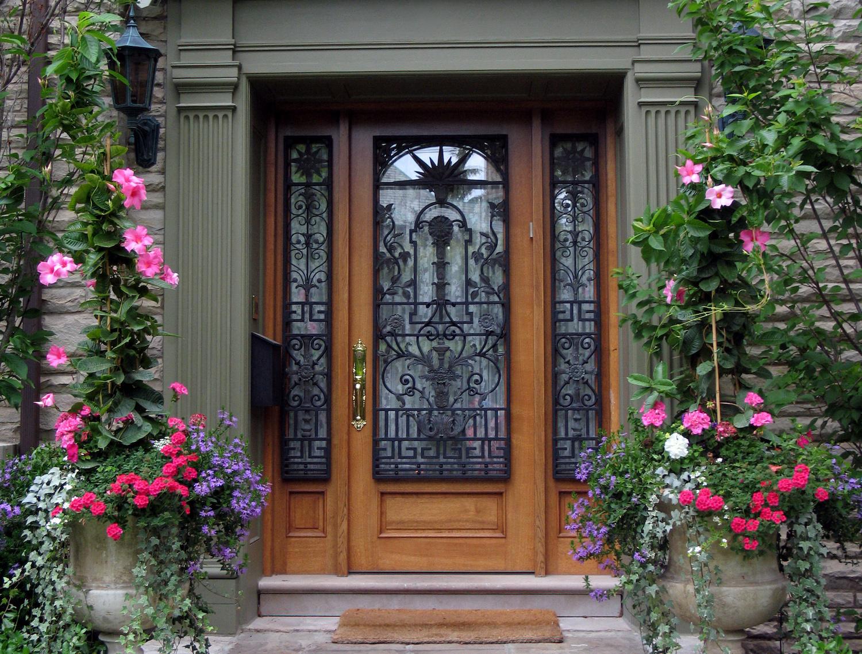 beautiful front door with flowers